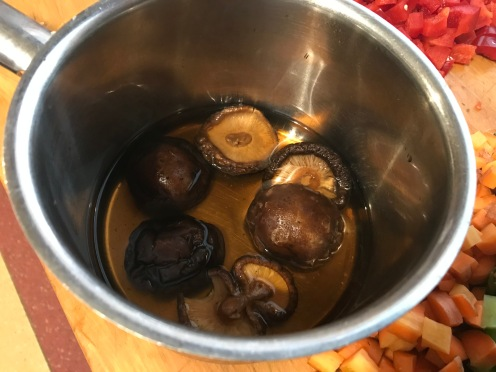 Soak your mushrooms for a half hour before proceeding with the recipe. You will use the mushrooms and the juice in the recipe.